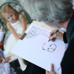 Deano drawing Caricatures at Wedding Reception  October Bride
